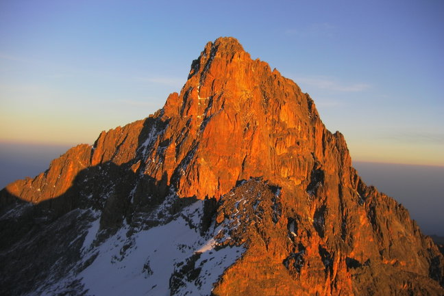Nelion, one of Mt Kenya's main summit spires, glows in the sunrise as viewed from our summit of Point Lenana