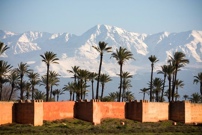 The High Atlas Mountains and the city walls of Marrakech