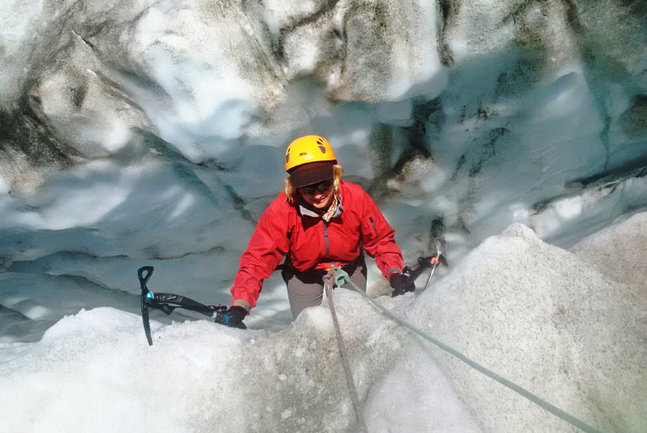 Climbing out of a crevasse using iced axes