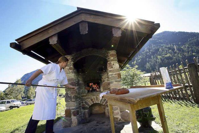 Baking bread in the outdoor oven at the Hotel Wiesenhof