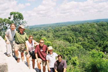Group on top of Tikal temple, Guatemala